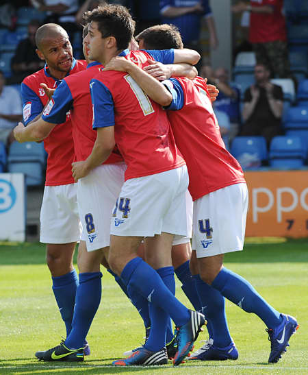 Gills players celebrate the opening goal