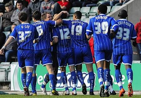 Gillingham players celebrate Joe Martins first half goal