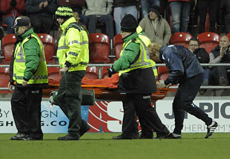 Romain Vincelot is carried away on a stretcher at Rotherham