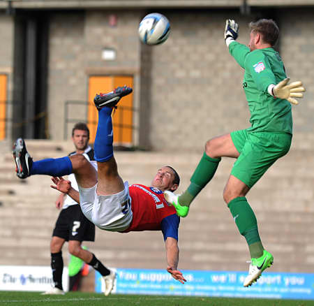 Andy Frampton executes an overhead kick