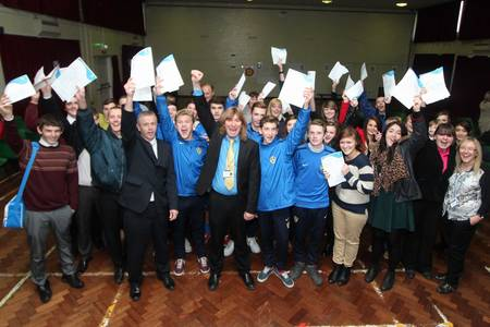 Teachers and pupils celebrate the exam results upgrade at The Isle of Sheppey Academy