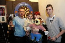 Charity Darts tournament to help raise money for the Oliver Smith appeal. Left to right, Barry Friday, Oliver Smith and his mum Natalie with James Friday.