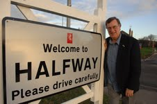 Cllr Ken Pugh and the new sign at Halfway