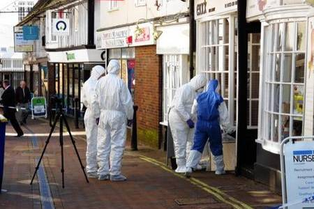 Police forensics officers at Esacks Hair and Beauty in Ashford High Street. Picture: Andy Clark