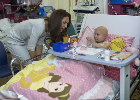 The Duchess of Cambridge chats with little Stacey Mowle during a visit to the Royal Marsden Hospital.