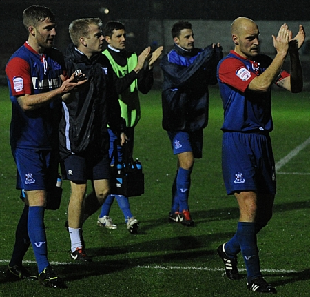The Gills players applaud the travelling fans for their support at the final whistle