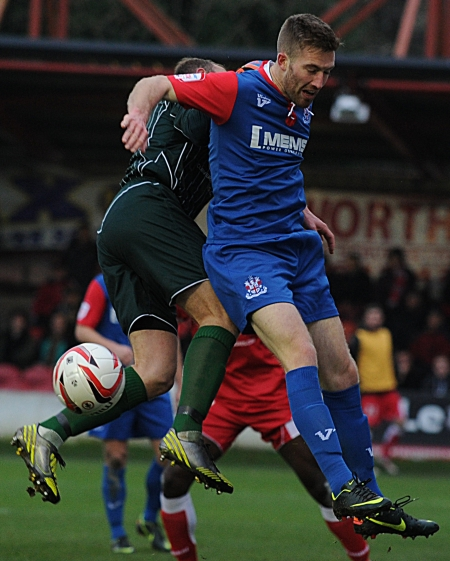 Matt Fish battles for the Gillingham cause