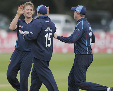 Adam Ball is congratulated after James Ords dismissal