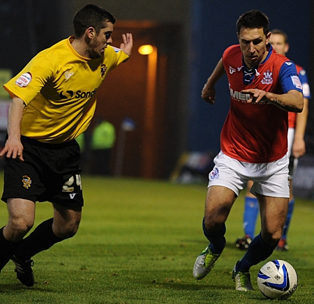 Joe Martin takes on Vale defender Richard Duffy