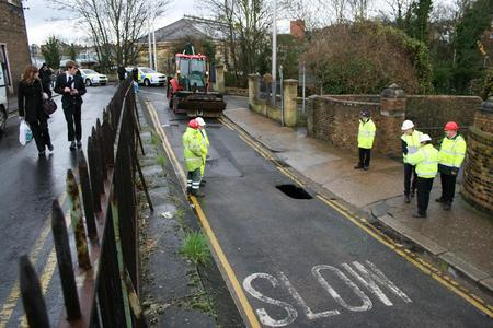 Engineers from Southern Water fix a burst water main in Hill's Terrace, Chatham