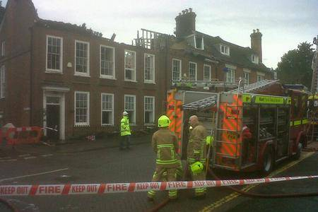 Crews assess the damage after a fire in West Malling. Picture: Martin Apps