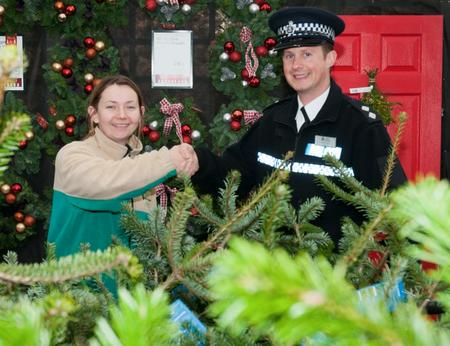 Pictured is Inspector Justin Watts of Kent Police and Anne O'Hare, Manager of Notcutts.