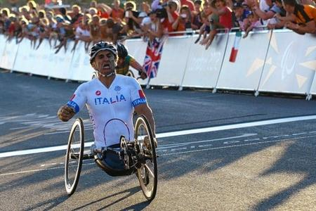 Alex Zanardi crosses the line to secure the Road Race gold medal